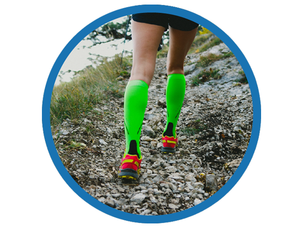 Trail runner wearing compression stockings